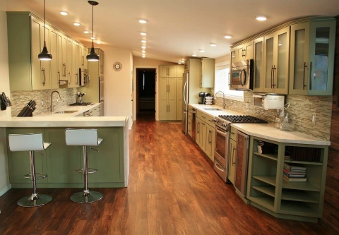 Custom Kitchen with green cabinets